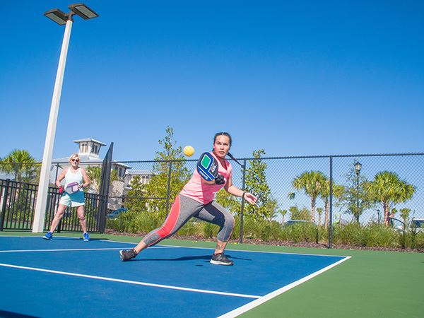 Woman playing pickleball on court in Waterset.
