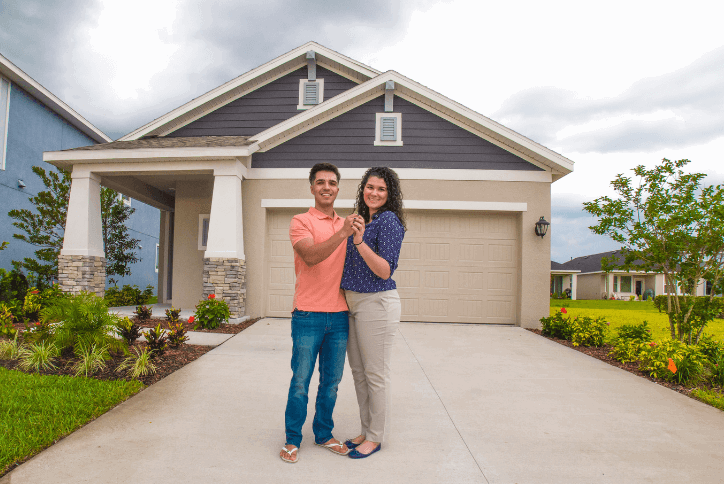 First-time homebuyers at their new construction home in Apollo Beach