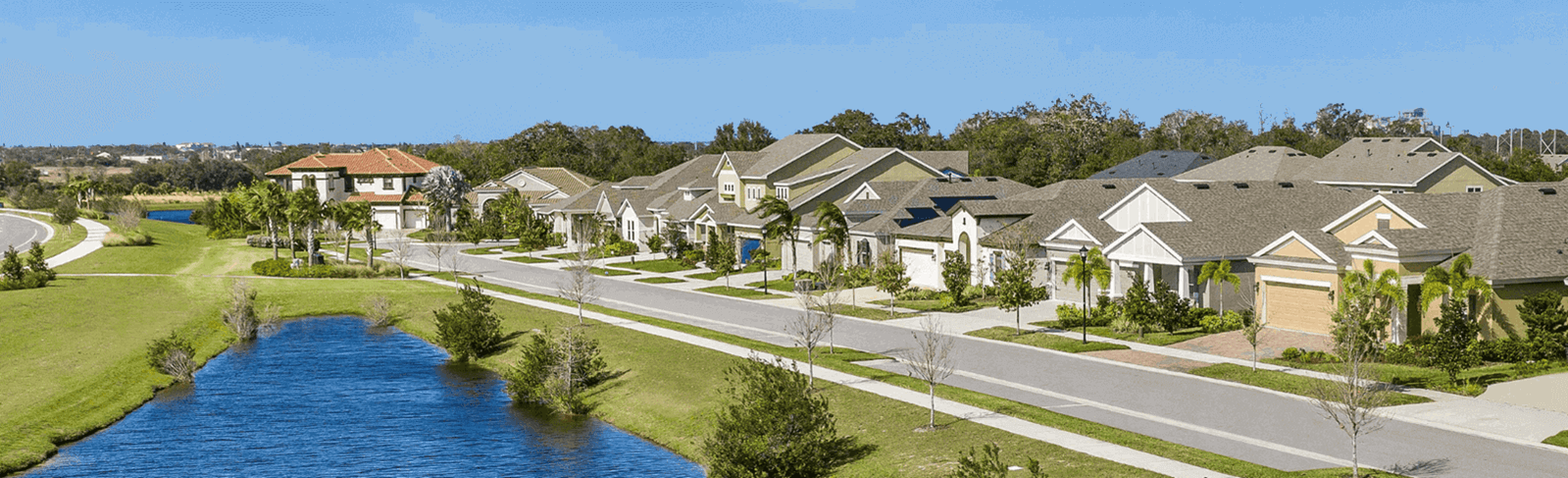 Homes along a lake in Waterset, new homes community in Apollo Beach.