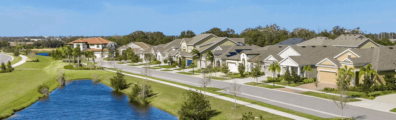 Homes along a lake in Waterset, new homes in Apollo Beach, FL.
